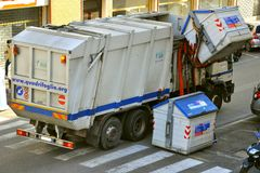 Garbage transport car loading. In Florence , Italy stock photography
