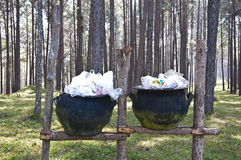 Garbage in trashs at pine forest Royalty Free Stock Photography