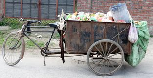 A garbage tricycle cart carrying variety of garbage under Swachh Bharat Abhiyan Mission royalty free stock image