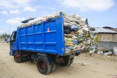 Garbage Truck. Overflowing with trash in old sacks Stock Photos