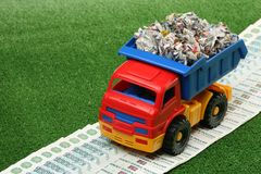 Garbage truck. And toll highway on a green background Royalty Free Stock Photos