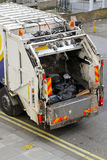 Garbage truck. Back of a city garbage truck with waste already inside Stock Photo
