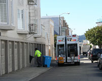 Garbage truck. And man collecting trash Royalty Free Stock Photo