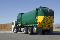 Garbage Truck. Makes a turn on a street corner Royalty Free Stock Photography