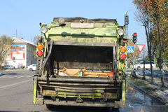 Garbage truck. Photo which shows a machine for collection and disposal of waste in landfills Royalty Free Stock Photos