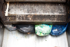Garbage Truck. Rear of garbage truck showing bags of rubbish royalty free stock photos