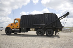 Garbage Truck. A modern garbage truck over a bright blue sky Stock Photos
