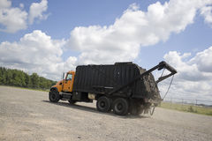 Garbage Truck. A modern garbage truck over a bright blue sky Royalty Free Stock Images