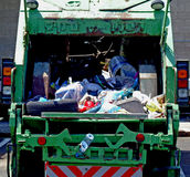 Garbage truck. A garbage collection truck, loaded with waste, litter, etc Royalty Free Stock Image