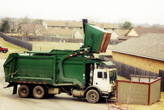 Garbage truck. Collecting trash in the city Stock Photography