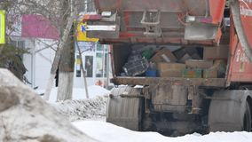 Garbage truck collects rubbish on the street. environmental pollution outdoors. Garbage truck collects rubbish on street. environmental pollution outdoors stock video footage