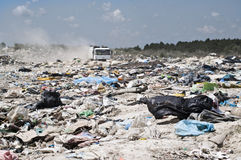Garbage truck comes in the landfill Stock Image
