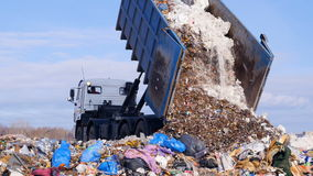 Garbage truck disposed trash on the landfill. Vehicle transporting garbage to waste. 4K stock video footage