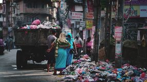 Garbage Truck Drops Trash and Rubbish on Thamel Street. Editorial Royalty Free Stock Photo