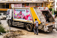 Garbage Truck. On duty checking dumpster and containers also waiting for the trash bring by locals. Like other heavy duty trucks,  is also belongs to local Stock Photography