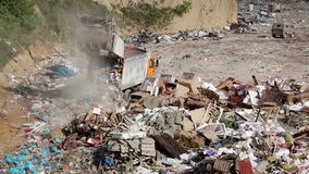 Garbage truck on landfill stock video