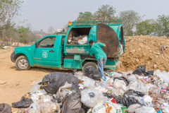Garbage truck of Pai Subdistrict Administrative Organization dumping Garbage at the garbage disposal pond Stock Photos