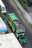 Garbage truck picking up trash. HONOLULU,USA - FEBRUARY 15,2017: Image of a municipal garbage truck picking up trash in Honolulu, Hawaii, USA royalty free stock images