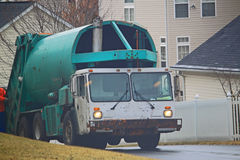 Garbage Truck. Picking up wastes in community Stock Photography