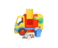 Garbage truck. Toy truck with a container full of torn newsprint, on a white background Stock Image