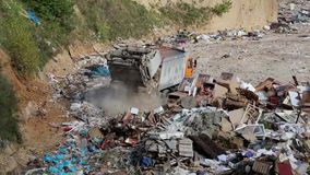 Garbage truck unloads waste. On landfill stock video footage
