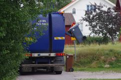 A garbage truck at work royalty free stock photography