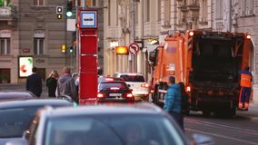 Garbage Truck Working In Evening Night Street. Dustcart, Trash Truck, Rubbish Truck, Junk Truck, Dumpster Specially. Prague, Czech Republic - September 22, 2017 stock video