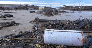 Garbage waste water pollution on beach by ocean sea stock footage