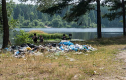 Garbage waste in the woods by the lake. 12.6.16. Russia river Nerscay royalty free stock image