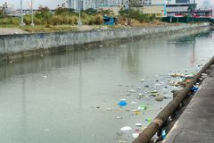 Garbage in the water. Bad ecology. River City. Stock Photo