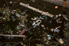 Garbage in the water in the city Stock Image