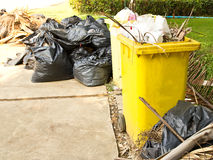 Garbage in the yellow trash Stock Image