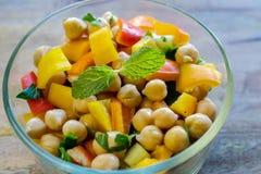 Garbanzo bean salad. Closeup on garbanzo bean salad in transparent glass bowl- healthy eating concept stock photo