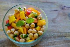 Garbanzo bean salad in glass bowl. Garbanzo bean salad in transparent glass bowl- healthy eating concept stock photo