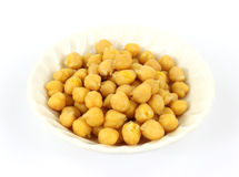 Garbanzo beans in bowl. A close view of garbanzo beans in a white bowl stock image