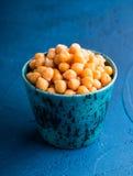 Garbanzo beans. Close up of a ceramic mug full of garbanzo beans royalty free stock image