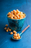 Garbanzo beans. Cup and spoon full of garbanzo beans stock images