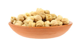 Garbanzo beans in small bowl. A serving of dried garbanzo beans in a small bowl on a white background royalty free stock images