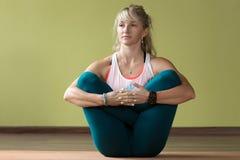 Garbha Pindasana Yoga Pose Royalty Free Stock Images