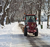 Garching, Germany -small salt truck at work on wintertime Stock Images