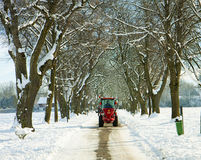 Garching, Germany -small salt truck at work on wintertime Royalty Free Stock Image