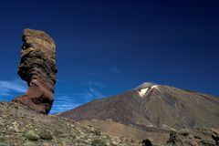 Garcia Rocks and Teide Volcano. The Teide Volcano in Tenerife, seen from the National Park of Las Cañadas, together with the Roques de Garcia also known as stock photos