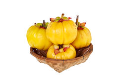 Garcinia cambogia fresh fruit, isolated on white. Fruit for diet. Garcinia cambogia fresh fruit on wood basket, isolated on white. Garcinia atroviridis is a Royalty Free Stock Photo
