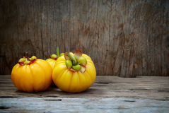 Garcinia cambogia fruit on wood background.  Fruit for diet and Stock Photography