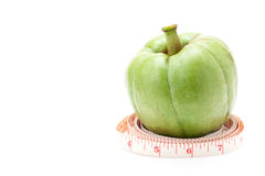 Garcinia Cambogia with measuring tape Royalty Free Stock Photography