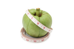 Garcinia Cambogia with measuring tape. Isolated on white background with clipping path Stock Photo