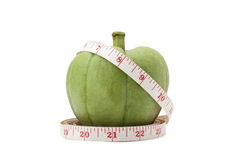 Garcinia Cambogia with measuring tape. Isolated on white background with clipping path Stock Image