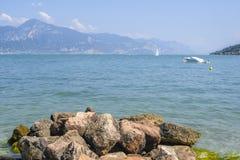 Boats on Garda lake in Italy. Garda, Italy - July, 31, 2018: boats on Garda lake in Italy stock image