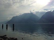 Garda lake the Mountains. Peaceful but dramatic atmosphere beside the Garda lake Stock Photography