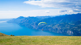 Garda lake with paraglider stock photography